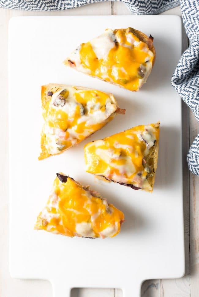New Orleans Muffuletta Cheesy Garlic Bread Recipe #ASpicyPerspective #garlicbread #cheesebread #muffuletta #neworleans