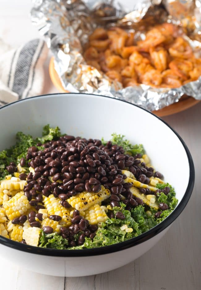 How to Make Mexican Salad with Chipotle Shrimp Recipe (+ Kale, Grilled Corn, Black Beans and Avocado!) #ASpicyPerspective #kalesalad #mexican #healthy #glutenfree