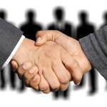 Two people shaking hands | Aspioneer