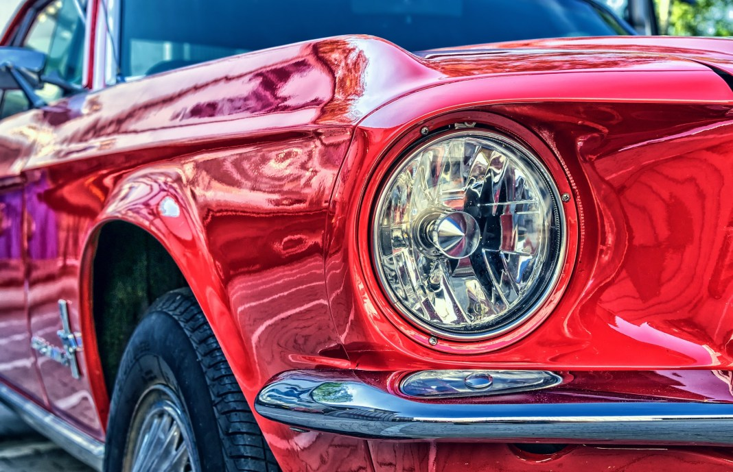 A classic Ford Mustang in red