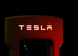 A Tesla charger photographed at night
