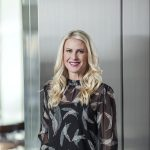 April posing at her office at Zurixx