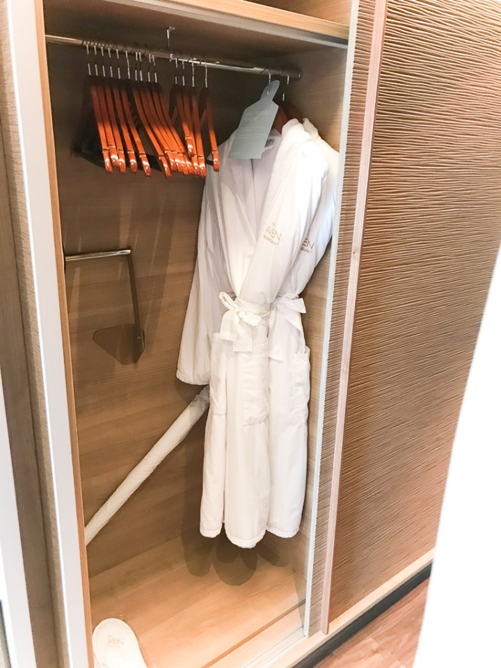 Closet and complimentary robes and slippers to use in Haven Spa Suite