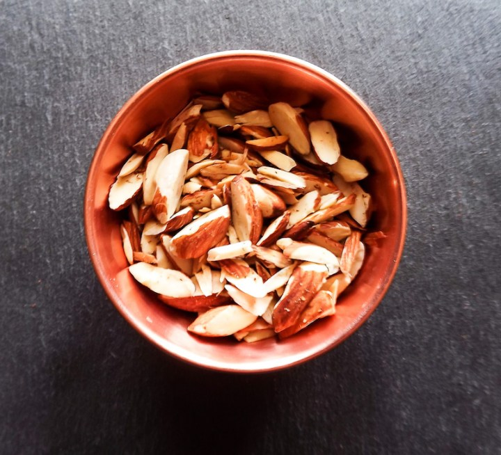 Overhead picture of toasted almonds in copper pinch bowl from Target | asprinkleandasplash.com