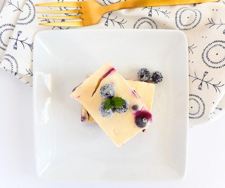 Lighter Lemon Blueberry Cheesecake Bars overhead picture | asprinklenandasplash.com