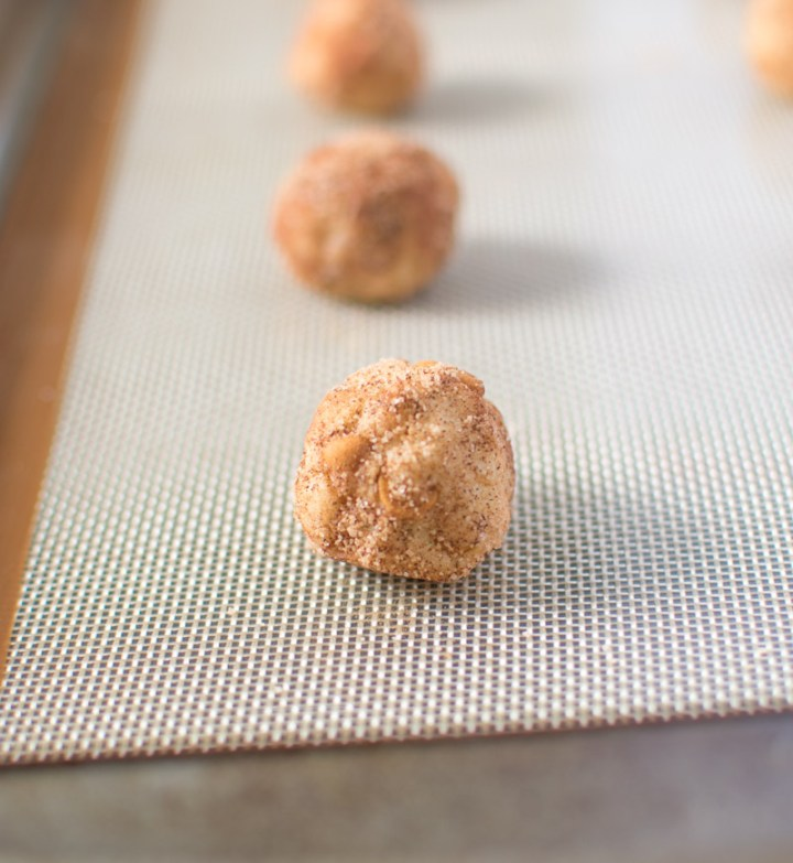 Close up picture of a cookie dough ball on a silicone mat