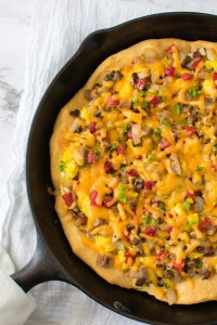 Skillet Breakfast Pizza closeup pic in skillet | asprinkleandasplash.com