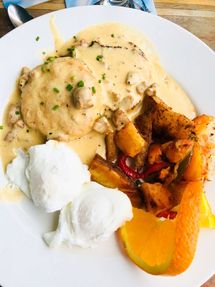 Biscuits and Gravy with poached eggs and home fries