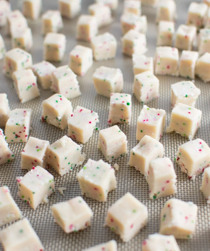 Closeup of cookie dough cubes on baking pan