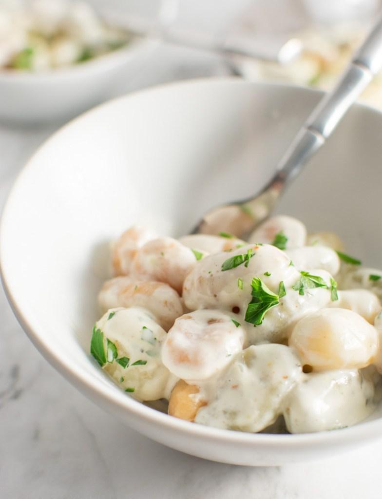 Close up of a bowl of Gnocchi with Gorgonzola Cream Sauce