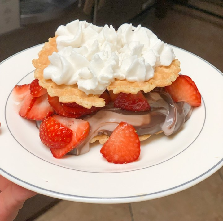 Dessert made with sugar free pudding, strawberries, pizelle cookies and almond milk whipped cream