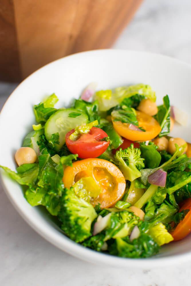 Rainbow Mediterranean Salad in white bowl