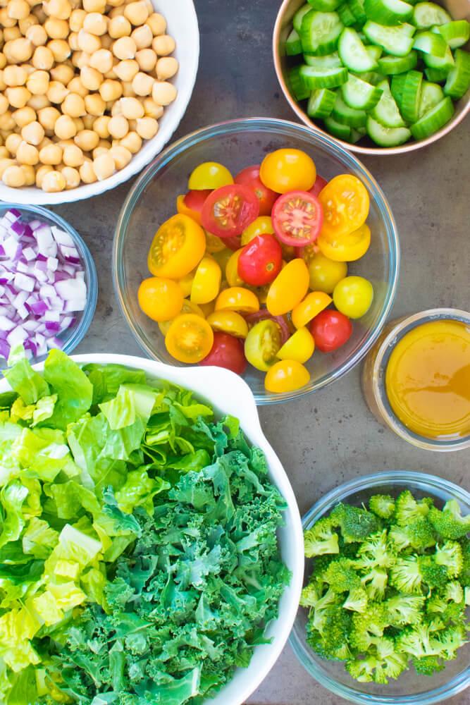 Salad ingredients in separate bowls