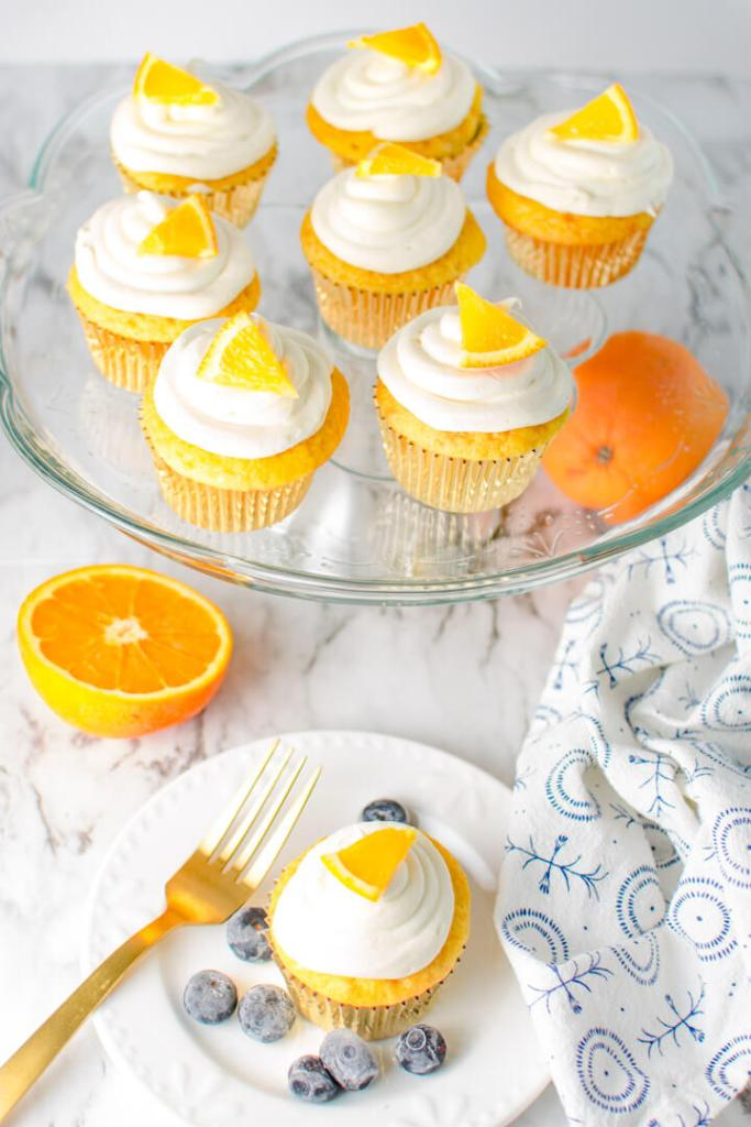 Serving platter of Orange Crunch Cupcakes and one cupcake on a plate