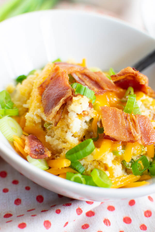 Closeup view of Loaded Baked Cauliflower Rice in serving bowl