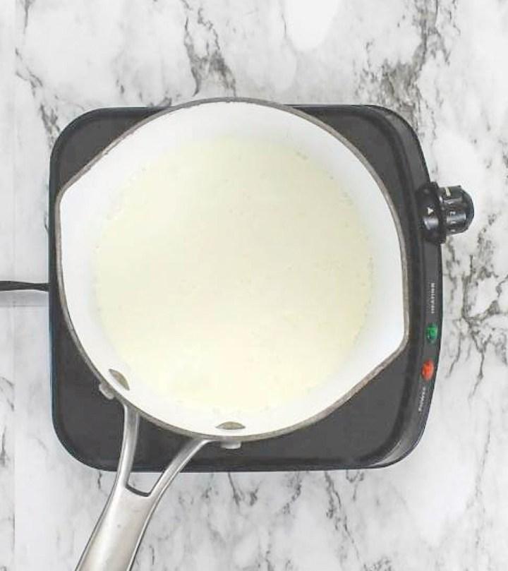 Cream heating up in saucepan