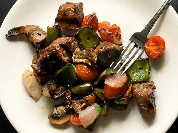 plated beef and vegetable skewers