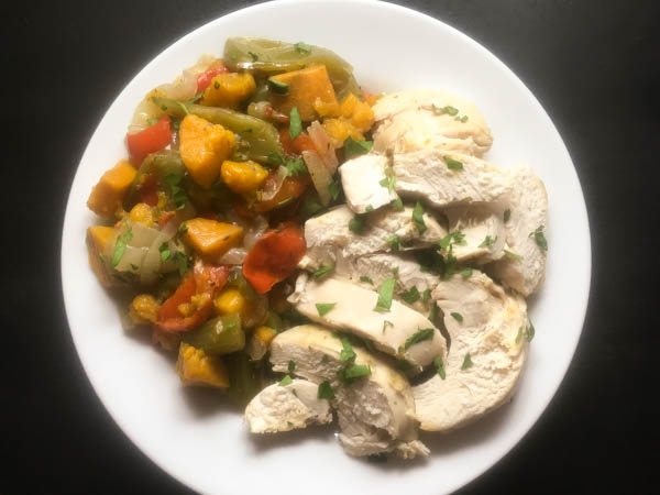 Scrumptious plate of Cajun slow roasted chicken with south Louisiana 'trinity' vegetables and sweet potatoes.