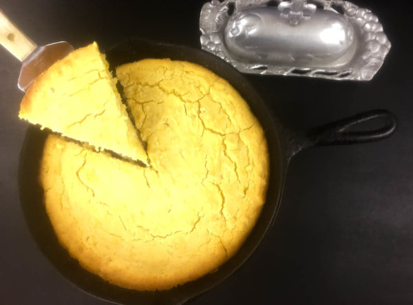 A piece of Gluten Free Skillet Cornbread being served. | http://asprinklingofcayenne.com