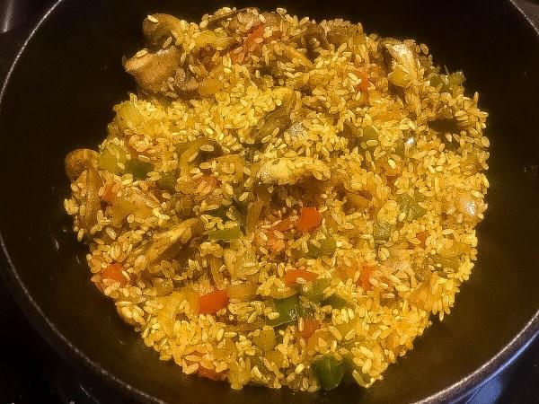 Seasoned Cajun Trinity Turmeric Rice With Mushrooms ready for final preparation.