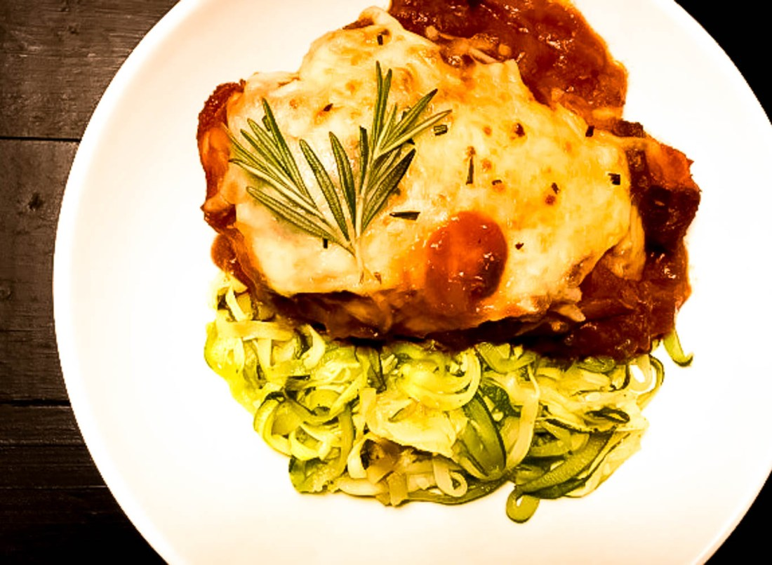 A plate of Gluten Free Broiled Rosemary Chicken Parmesan from A Sprinkling of Cayenne. | https://asprinklingofcayenne.com