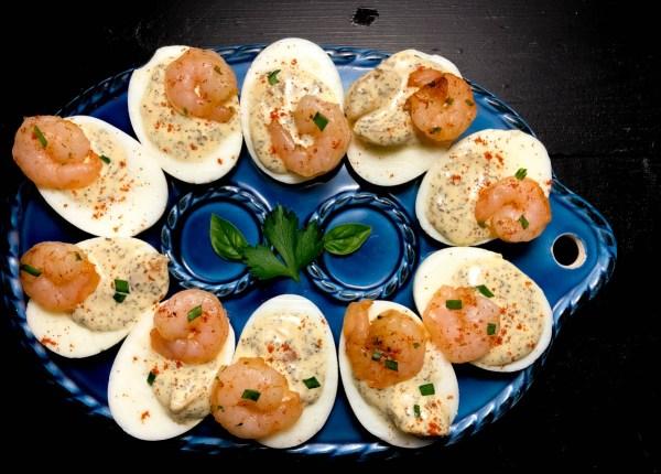 Creole Basil Aioli Shrimp Stuffed Eggs with fresh parsley and basil. | https:aprinklingofcayenne.com