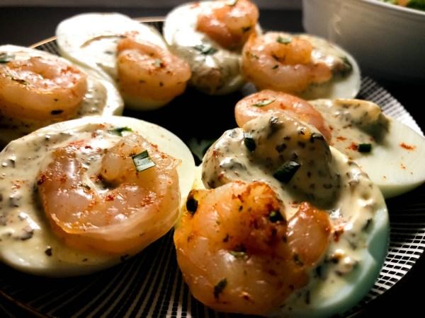 Creole Basil Aioli Shrimp Stuffed Eggs on a small plate. | https://asprinklingofcayenne.com