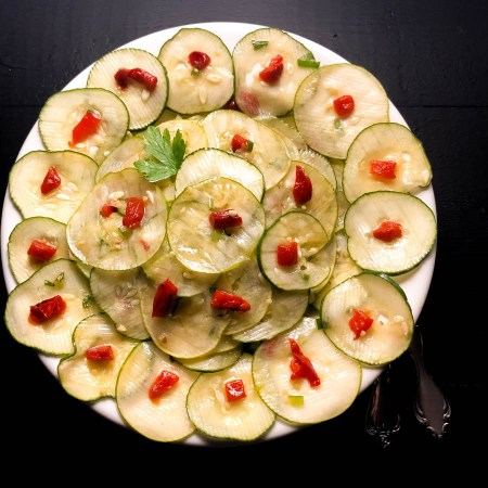 Square image of Cajun Marinated Cucumber Salad. | https://asprinklingofcayenne.com