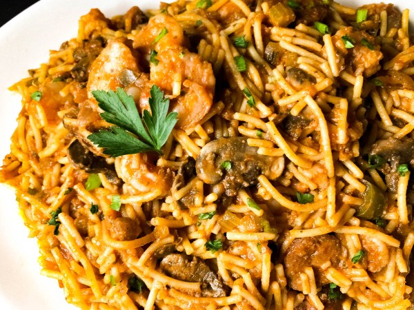 Shrimp, mushrooms and chicken pieces in red gravy with gluten free spaghetti.