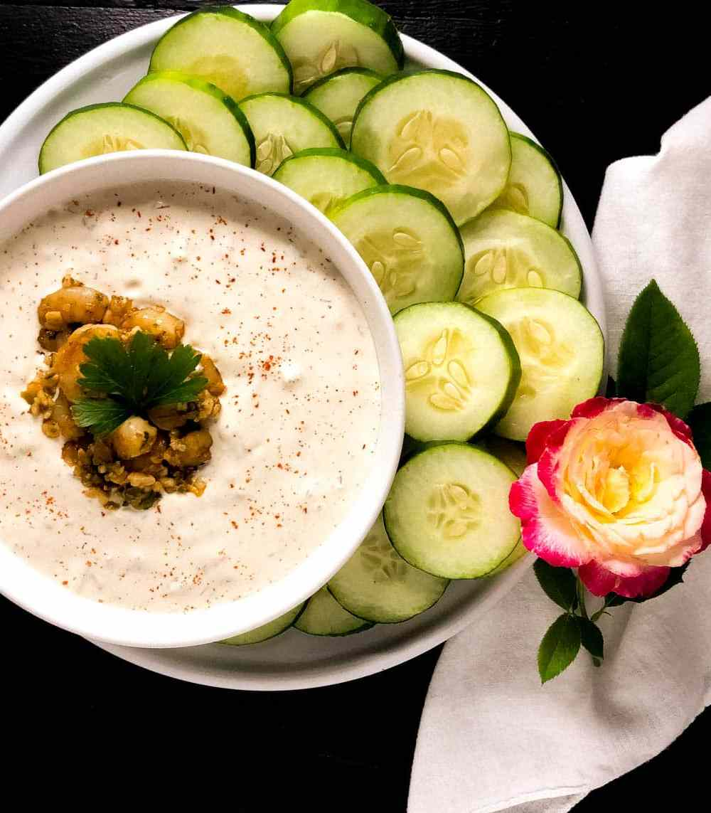 A round white bowl filled with Low Carb Cajun Shrimp Cucumber Dip