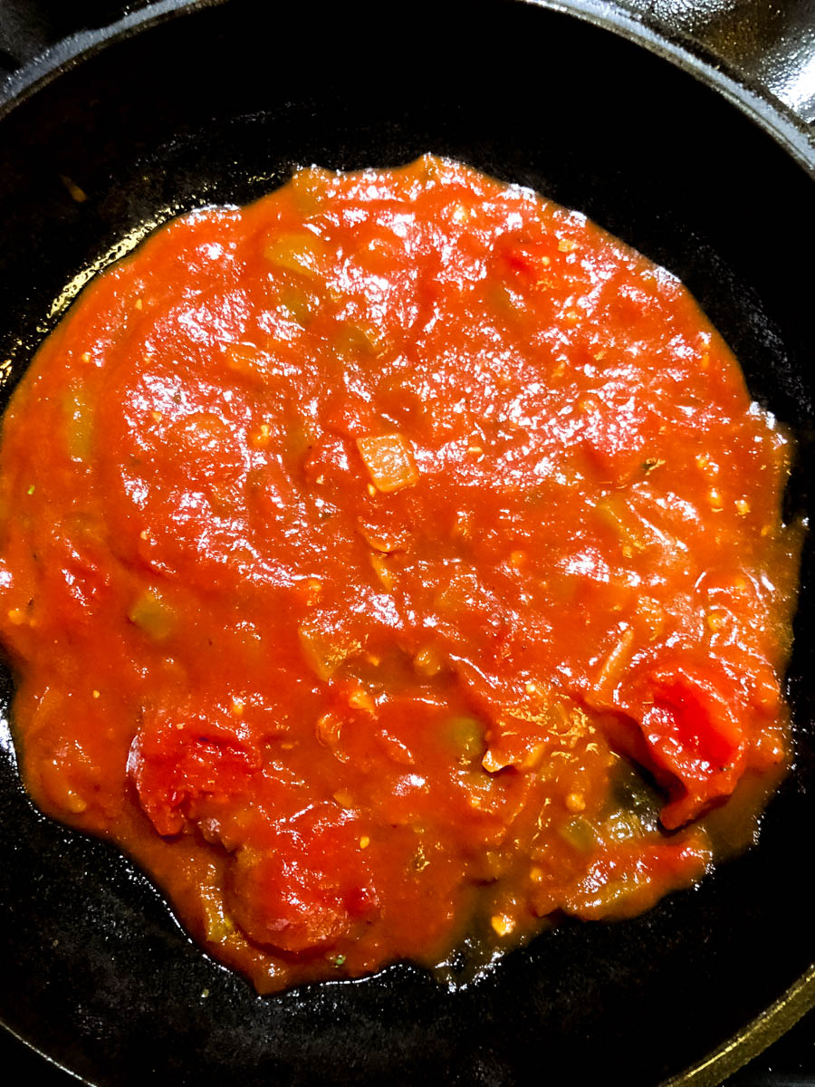 The first red gravy layer of Creole style gluten free eggplant Parmesan