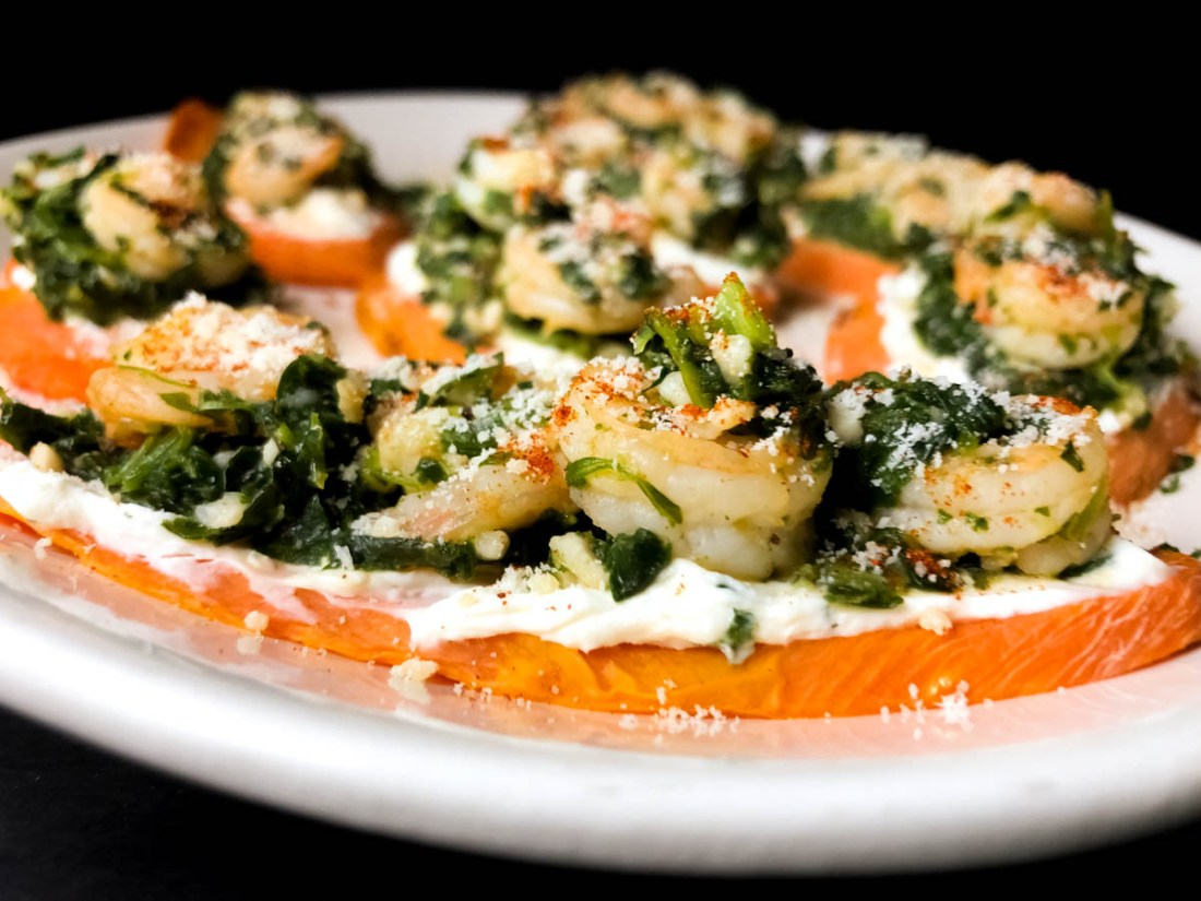 Side shot of Gluten Free Garlic Shrimp & Spinach PotaTOASTS