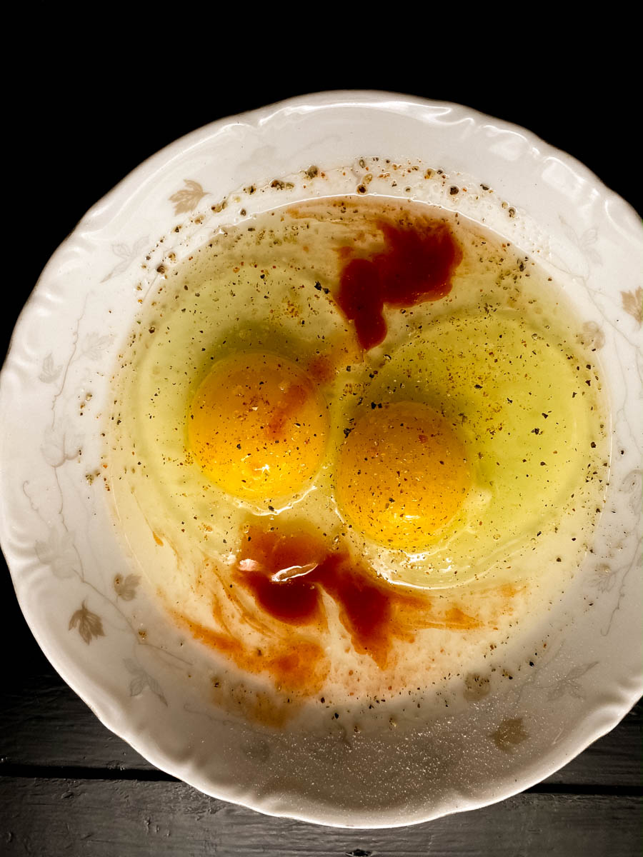 Egg wash with spices in a bowl.