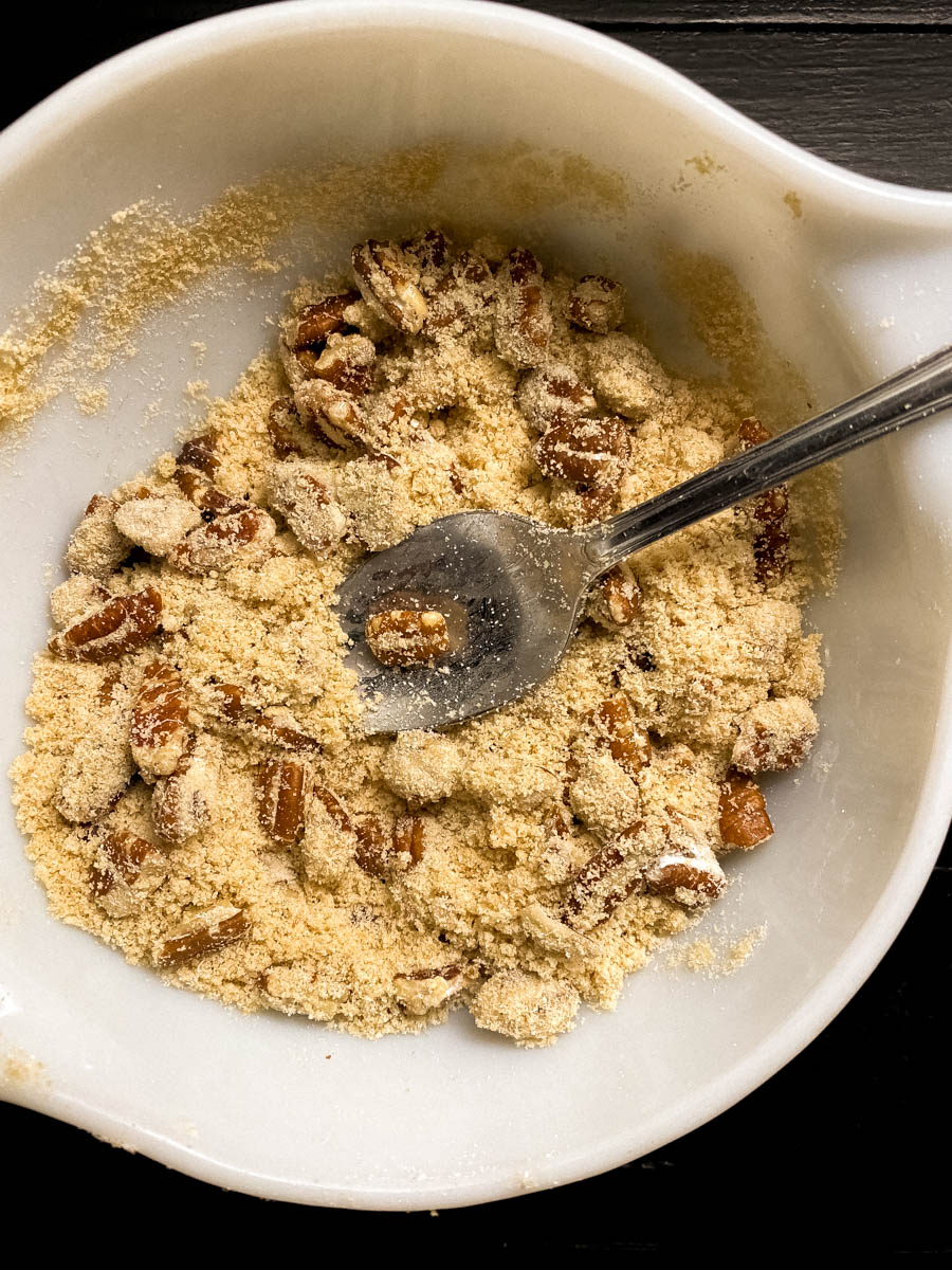 Pecans, melted butter, and brown sugar in a bowl