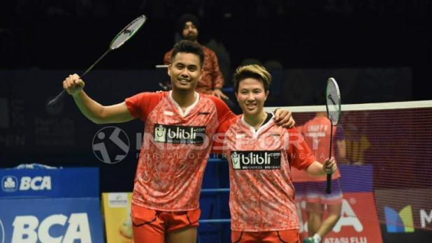 Indosport - Tontowi Ahmad/Liliyana Natsir meraih gelar juara Indonesia Open 2017.