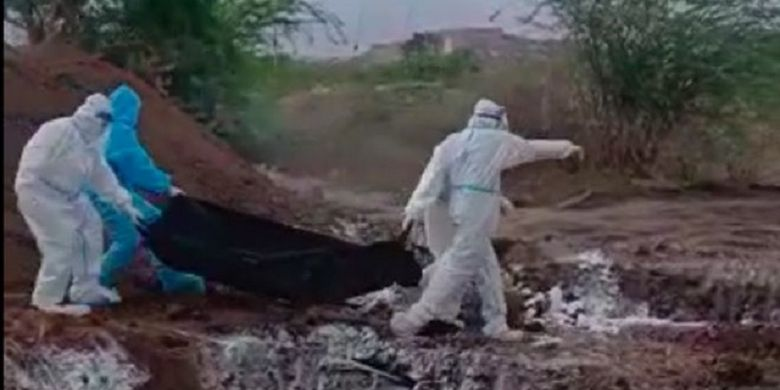 Video footage shows officers in Karnataka, India, dumping the bodies of Covid-19 victims into pits.  Local officials apologized after the video went viral.