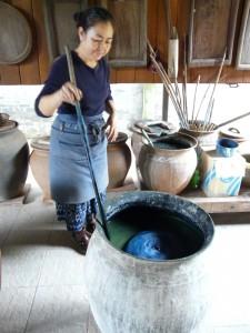 Stirring the indigo pot in Laos.