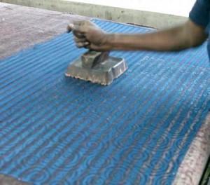 Block printing silk fabric.