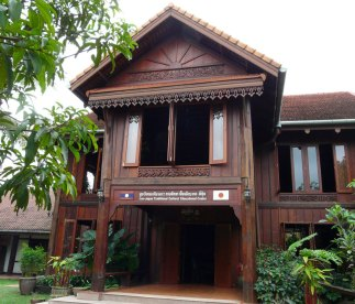 The Center's primary building is of French Colonial style with carved teak ornamentation.
