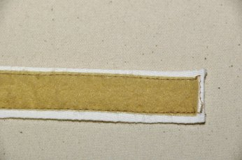Sewn soft side of Velcro onto twill tape.
