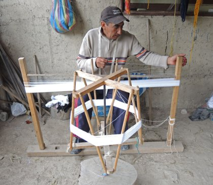 Jose´winds a cotton warp to make his ikat shawls.