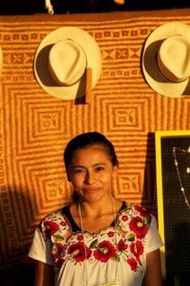 Mexican artist Germina stands in front of her nunkini palm rug.