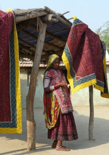 Ramu's mother handstitches many quilts.