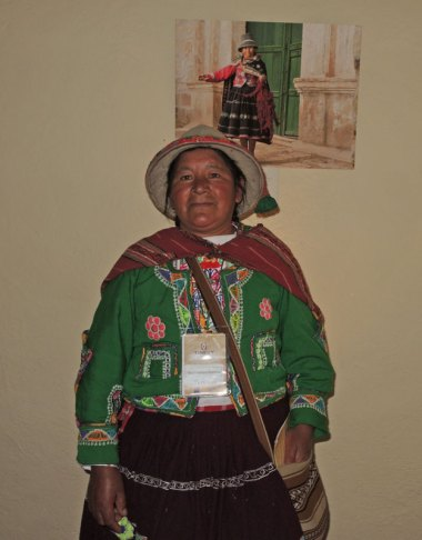 The daughter of Acopia elder Jeronima Jancco Futuri poses in front of the photo of her mother.