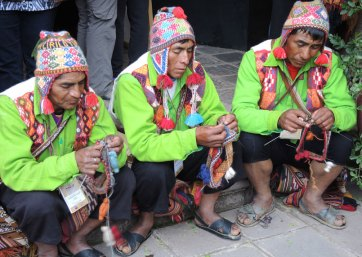 The Sallac men knit chullos during the coffee break.