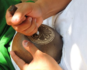 The bottom of gourd being carved.