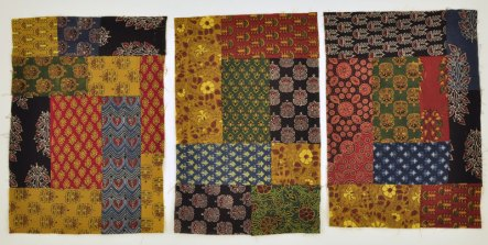 Ajrakh block printed fabrics that are pieced into quilt squares.