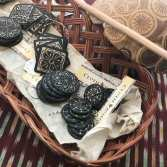 Handcarved gourd buttons from Oaxaca.