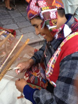 A weaver from Pitumarca working on traditional tapiz during Tinkuy 2013.