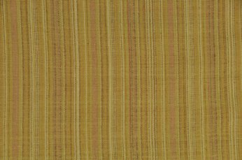 A unique striping pattern in organic hand woven, naturally dyed cotton.